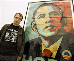 "Artist Shepard Fairey poses beside his ""Obama HOPE"" image, part of an exhibit of his work at the Institute of Contemporary Art Tuesday in Boston."