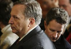 National Economic Council Director Lawrence Summers, left, awaits President Obama at the White House on Friday.
