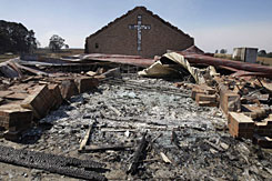 The remains of St. Andrew's church are scattered after it was destroyed by fire in the community of Kinglake, northeast of Melbourne on Monday.