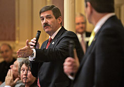 Del. John Cosgrove, R-Chesapeake, debates on a state smoking ban in restaurants, as Del. Thomas Gear, R-Hampton, right, listens in the House of Delegates at the Capitol in Richmond, Va., on Monday. The House gave preliminary approval to an amended version of the bill.