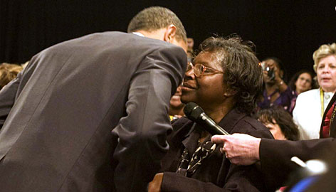 "President Obama embraces Henrietta Hughes at a town-hall-style meeting Tuesday in Fort Myers, Fla. Hughes, who is homeless, told the president, ""Please. We need help."""