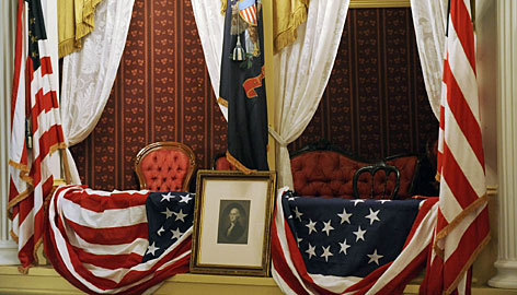 A private box is decorated at historic Ford's Theatre in Washington on Wednesday, as it was in 1865 when former President Abraham Lincoln was fatally shot by an assassin there. The newly-renovted playhouse is celebrating its re-opening to coincide with the 200th anniversary of Lincoln's birthday.