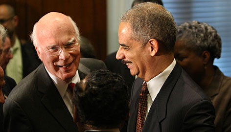 Senate Judiciary Committee Chairman Patrick Leahy greets Attorney General Eric Holder on Feb. 3. Holder has said waterboarding is torture.