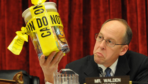 Rep. Greg Walden, R-Oregon, holds up a container holding products made with peanut butter from the Peanut Corporation of America at a House hearing Wednesday.