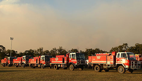 Fire trucks arrive back at Healesville at the end of the day on Thursday in Healesville, Australia. Victoria Police have revised the bushfire disaster death toll to 181, the worst in Australia's history.