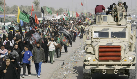 Iraqi Shiite pilgrims march from Baghdad to Karbala on Thursday during their annual pilgrimage to mark the end of mourning following the anniversary of the seventh-century death of the prophet Mohammed's grandson.