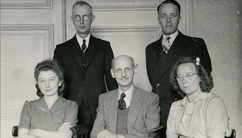 Miep Gies, seated left, the last surviving helper of Anne Frank and her family, is shown with Otto Frank, seated center, and the helpers Bep Voskuijl, seated right, Johannes Kleiman, standing left, and Victor Kugler, standing right.