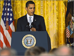 President Obama addresses the Business Council in the East Room of the White House Friday as Congress prepares to vote on an economic stimulus package.