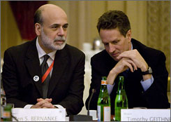 Treasury Secretary Timothy Geithner, right, talks with Federal Reserve Chairman Ben Bernanke during a meeting of world financial leaders in Rome Saturday.