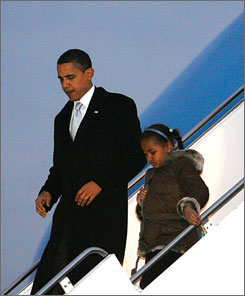 President Obama will sign the stimulus bill passed by Congress on Tuesday in Denver. Here, the president and daughter Sasha walk down the steps from Air Force One on Saturday as they arrive in Chicago for the weekend.