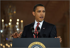 """President Barack Obama described the bill's passage as a """"major milestone on our road to recovery."""""""