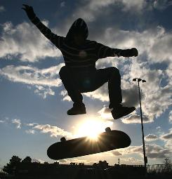 Octavio Varela does some air aerobics on his skateboard in El Paso.