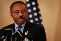 Sen. Roland Burris, D-Ill., shown here at a news conference in Chicago on Sunday, says his decision to file a new affidavit regarding events leading up to his appointment was not motivated by revelations about secret recordings.