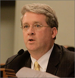 Illinois Rep. Jim Durkin, the state's Republican leader, is calling on U.S. Sen. Roland Burris, D-Ill., to resign. Burris has admitted being asked for campaign donations by the brother of ousted Gov. Rod Blagojevich before he was appointed to take over the Senate seat once occupied by President Obama. Here, Durkin is seen at the state capital in Springfield on December 29.