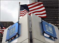 President Obama has decided to create a task force to help revive the ailing American auto industry. Here, the General Motors logo on the company's headquarters in Detroit in seen on December 12.