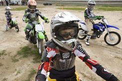 Schuyler Yager, 10, front, listens Sunday to an instructor at the School of Dirt in Irvine, Calif.