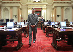 As the discussion over the state budget raged, Senate President Pro Tem Darrell Steinberg, D-Sacramento, paces the floor at the Capitol in Sacramento, on Monday. The Senate failed to act on the spending plan, hammered out by Gov. Arnold Schwarzenegger and legislative leaders, and is expected to take it up for a vote on Tuesday.