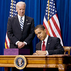 President Obama signs the American Recovery and Reinvestment Act into law Tuesday in Denver as Vice President Biden witnesses.