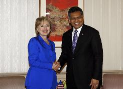 Secretary of State Hillary Rodham Clinton shakes hands with Association of Southeast Asian Nation Secretary General Surin Pitsuwan in Jakarta on Wednesday.