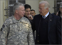 Vice-President Biden, right, talks with Gen. David McKiernan, commander of the NATO-led international troops in Afghanistan, during a visit to Kabul January 10.
