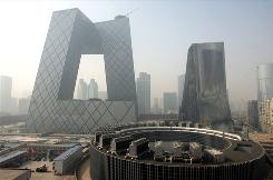 A fire damaged the Mandarin Oriental Hotel, right, part of a complex that houses Chinese Central Television's headquarters in Beijing.