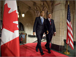 President Obama and Canadian Prime Minister Stephen Harper arrive on Parliament Hill in Ottawa Thursday during Obama's first foreign trip since taking office.