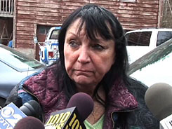 Sandra Herold, owner of Travis the chimpanzee, speaks to reporters in Stamford, Conn., on Wednesday.