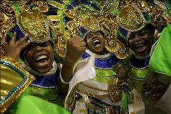 Revelers parade at the Sambadrome as part of Carnival celebrations in Sao Paulo Friday night.