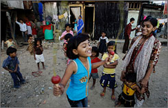 Rubina Ali Qureshi, 9, center, jumps rope as her friends look on near her home in a slum in Bandra, suburban Mumbai, India, Jan. 25. Rubina played the youngest version of the leading lady Latika.