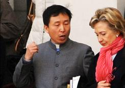 Secretary of State Hillary Clinton chats with a Chinese church official as she leaves the Haidian Christian Church on Sunday in Beijing.