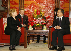 "Secretary of State Hillary Clinton meets with Chinese Premier Wen Jiabao in Beijing Saturday where she vowed that the U.S. will have a ""positive, co-operative relationship"" with China."