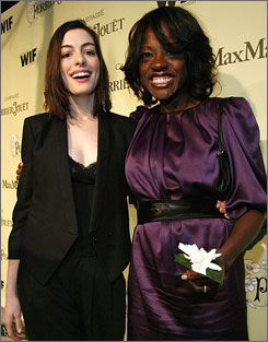 Oscar nominees Anne Hathaway, left, and Viola Davis pose at the second annual Women in Film pre-Oscar party in Los Angeles Friday night.