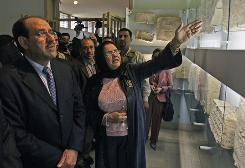 Amira Eidan, center, director of Iraq's National Museum, shows Iraqi Prime Minister Nouri al-Maliki recovered antiquities on the day the museum was formally rededicated in Baghdad.