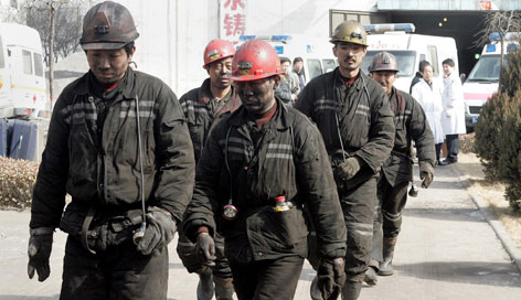 Chinese miners make their way out of the Tunlan Coal Mine in the northern Chinese province of Shanxi on Sunday after a gas explosion caused the worst accident in the country's mines in over a year.