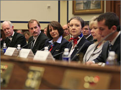 The pilots and crew of US Airways Flight 1549 listen to air traffic controller Patrick Harten testify before a House Transportation and Infrastructure Aviation Subcommittee.