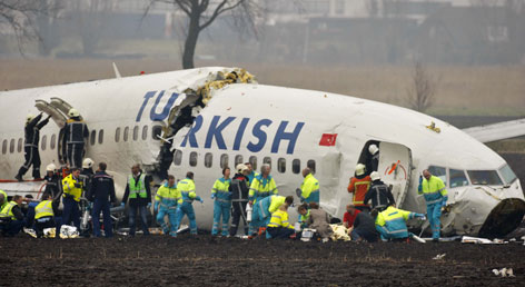 Rescue crews aid survivors Wednesday after a Turkish Airlines jet broke into three pieces upon crash-landing in Amsterdam.
