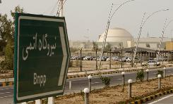 "A sign reading ""Atomic Power plant"" points the way to the nuclear power plant in Bushehr, Iran, Iranian and Russian technicians are conducting a test run of the plant."