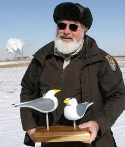 Bill McCoy, manager of the Patoka River National Wildlife Refuge, holds decoys used to attract Terns to the Cane Ridge Wildlife Management Area at the Gibson Generating Station in Gibson County,IN.