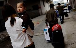 A migrant worker family prepares to return to their hometown after the jean factory where they worked closed down, at the Dadun Village on February 20 in Guangzhou of Guangdong Province, China.