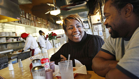 LaJuan Young, 39, and her husband, Terrence, both of Washington, eat breakfast at the Florida Avenue Grill.