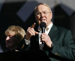 "James Dobson, founder of Focus on the Family, speaks next to his wife Shirley Dobson, during a ""Yes on 8"" prayer event to ban gay marriage at Qualcomm Stadium in San Diego Nov. 1."