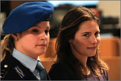 Amanda Knox, right, arrives at a murder trial session in Perugia, Friday. Knox and her ex-boyfriend, Raffaele Sollecito, are on trial for the murder of British student Meredith Kercher in November 2007.