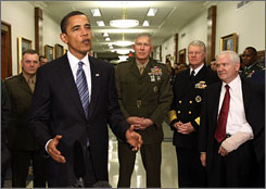 President Obama speaks at the Pentagon on Jan. 28 after meeting with Defense Secretary Robert Gates, right, and military officials.