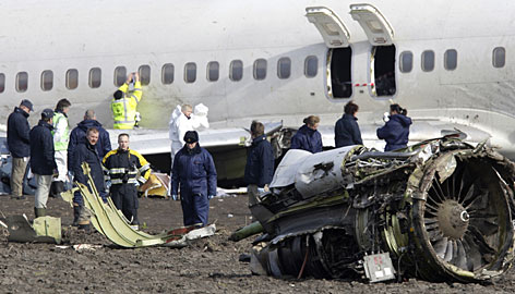Crash investigators examine the wreckage of the Turkish Airlines plane at Amsterdam's Schiphol Airport on Thursday.