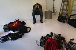 Staff photographer Matt McClain waits to turn in his photo equipment in the Rocky Mountain News photo studio on Friday in Denver. Today's edition was the last for the nearly 150-year-old daily, Colorado's oldest newspaper. Parent company E.W. Scripps Co. announced yesterday that the paper would close after efforts to find a buyer failed. McClain was one of some 200 staffers to lose their jobs.
