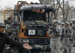 U.S. soldiers inspect the site of a Jan. 17 blast that killed two U.S. service members and wounded a dozen in Afghanistan's capital, Kabul.