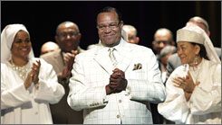 Minister Louis Farrakhan arrives to address the crowd at an annual Nation of Islam meeting.