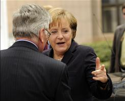 German Chancellor Angela Merkel arrives today at an economic summit of European leaders in Brussels.