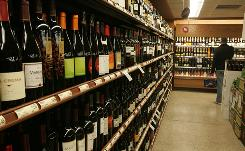 A customer shops at a Wegmans in Fairfax, Va., one of 35 states that allow grocery stores to sell wine.