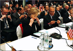 Secretary of State Hillary Rodham Clinton attends the opening session of the Gaza reconstruction conference Monday in Sharm el-Sheik, Egypt.